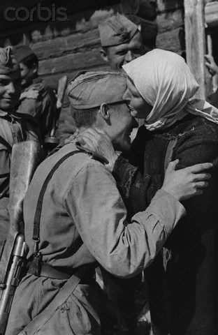 Anna Solovyeva, a collective farmer of Kapustnovo village, Smolensk region, embraces a soldier of the Red Army after the liberation of her village.