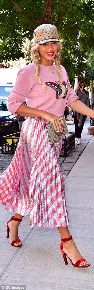 Oh dear: His wife Beyonce meanwhile, who has no such sordid skeletons on her CV, looked as though she needed to sack her stylist wearing head-to-toe pink Gucci