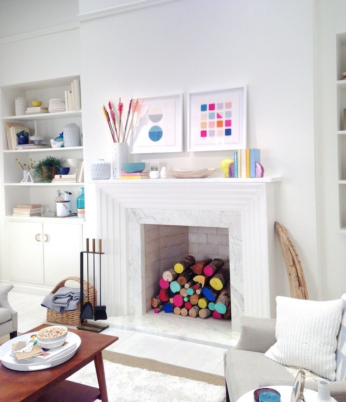 White fireplace with lots of color.