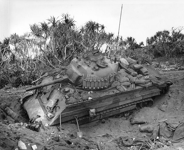 An M4 Sherman tank stuck in the loose volcanic sand of Iwo Jima, Feb. 21, 1945.