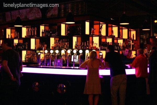 Sale Street Bar.  Superb.  Calamari on the bar menu is best I've ever tasted.  Outdoor area great on decent day.  Indoor stylish.  Loving.