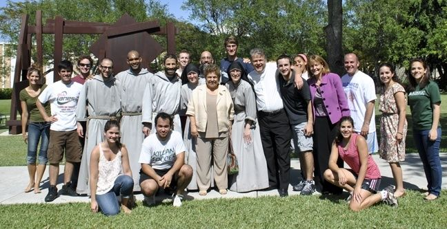 University of Miami President Donna Shalala and Vice-President Patricia Whitely stop for a moment to meet the Franciscan Friars and Sisters of the Renewal, joined by Msgr. Michael Carruthers, St. Augustine's pastor, Father Eric Zegeer, associate pastor, campus minister Michelle Ducker, and students.