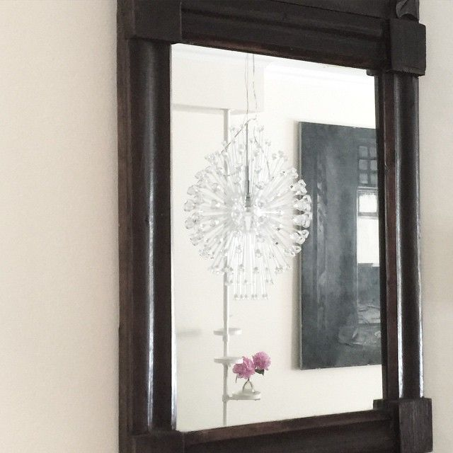 Mirrors! Great for creating a feeling of more space in your room. Mirrors also help reflecting the light and can make a dark area or corner a lot brighter.