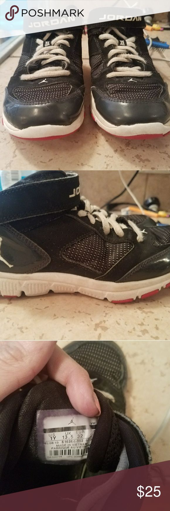 Kids Jordans size 1y Kids Jordan shoes size 1y black they have been used may need some new laces they are in good condition jordans Shoes Sneakers