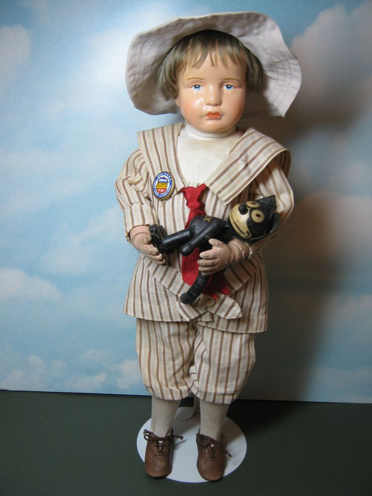 Early Schoenhut boy holding Felix the cat. He was copied from the K*R 114 bisque head doll.