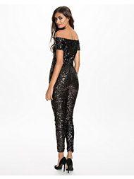 http://nelly.com/se/kl%C3%A4der-f%C3%B6r-kvinnor/kl%C3%A4der/jumpsuit/french-connection-117/cosmic-sparkle-slashneck-midi-dress-117783-14/