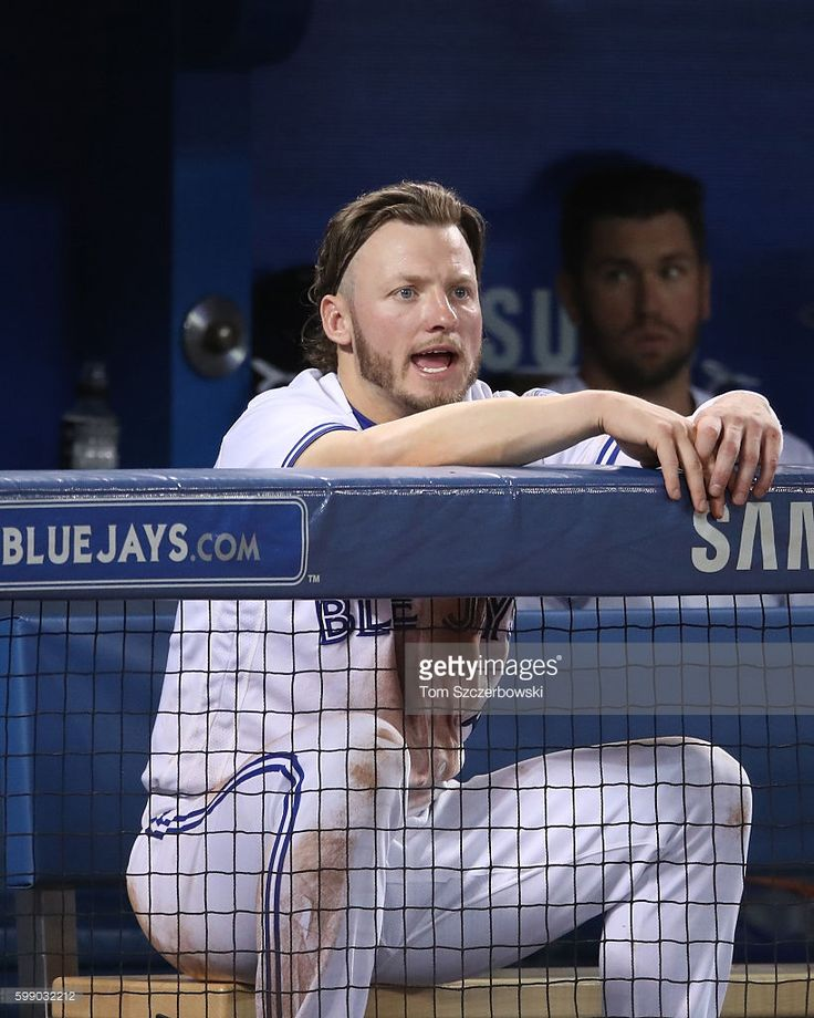 Josh Donaldson #20 of the Toronto Blue Jays screams out from the top step of the…