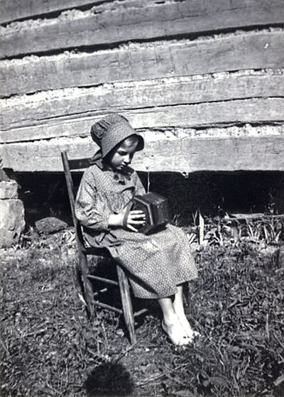 Young girl playing the concertina in 1920.