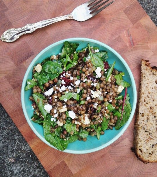 This lentil salad comes together in minutes, and is tossed with dried cranberries, goat cheese, capers and spinach.