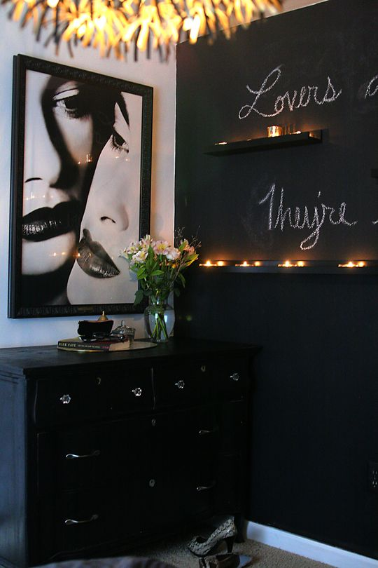 Chalkboard wall= cool but probably wouldn't do.. Love the shelves w/ candles & the art on the wall.