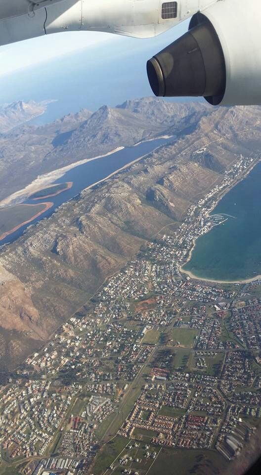 Gordon's Bay ~ Gordon's Bay is a harbour town in the Western Cape province of South Africa, close to Strand. It is situated on the northeastern corner of False Bay about 50 km from Cape Town.
