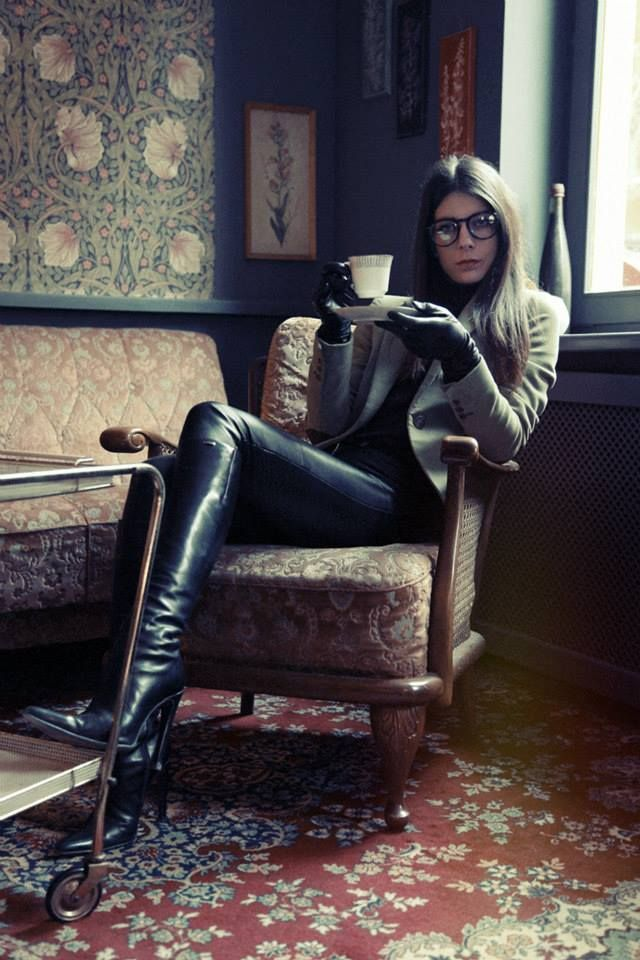 Black leather pants, tall high heel boots, leather gloves, glasses ...