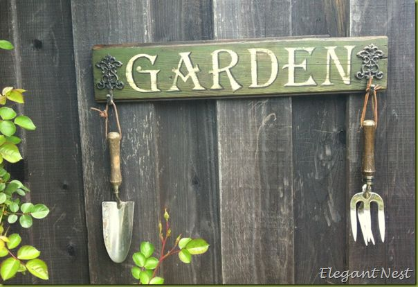 Love the idea of a garden sign with a blessing painted or carved into the wood.  You can hang charged crystals, stones, or even carved runes instead of garden tools. Lots of room for variation and customization.