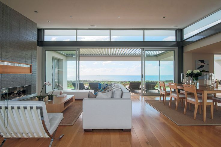 Clerestory windows allow light to spill over the covered terrace and into the living area.