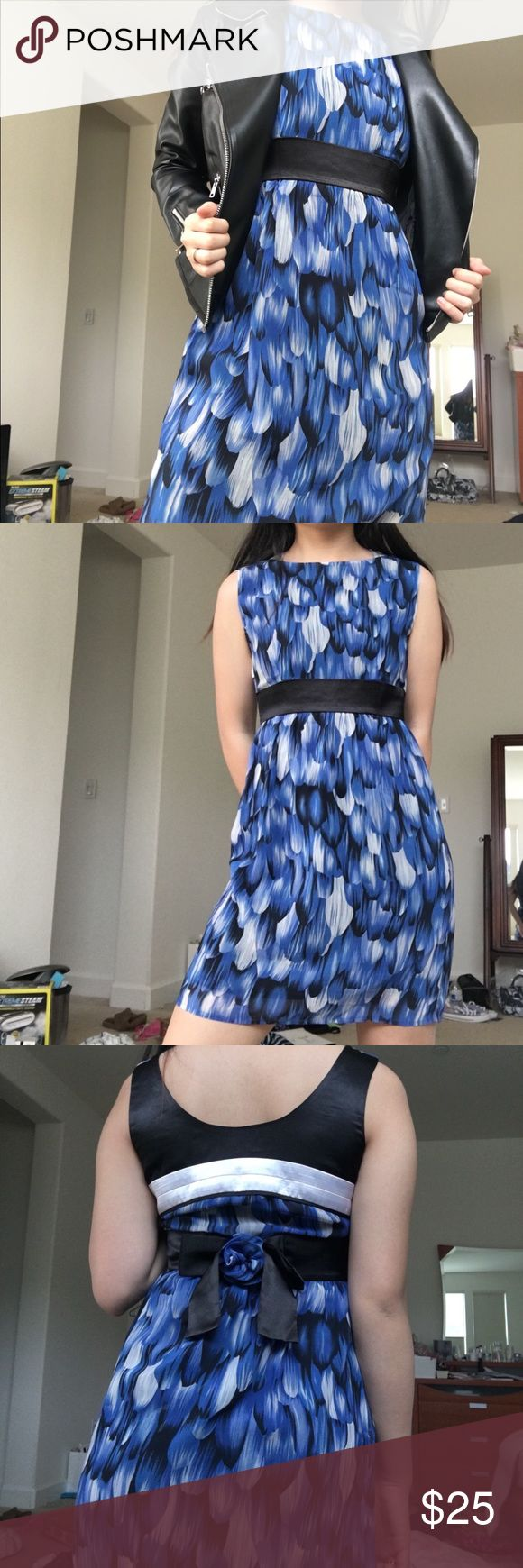 Royal Blue Patterned Dress Gorgeous blue, black, and white patterned dress! Bow detailing on the back and above knee length. No flaws, styling option shown in the first picture. Marked as an XS and seen on a small. Perfect style and fit, can be dressed up or down for any occasion! Dresses