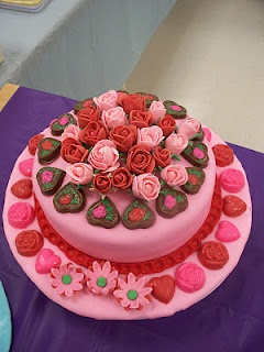 Valentine Cake with fondant roses and homemade chocolate hearts and roses.