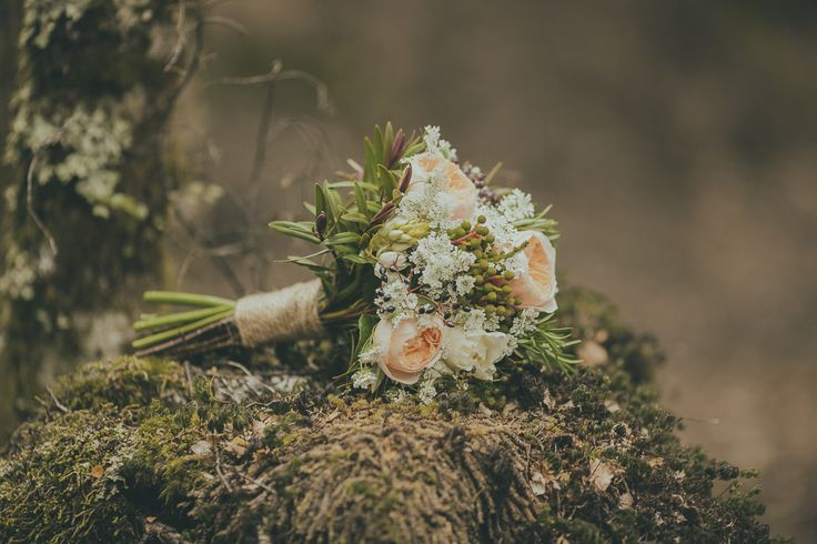 Love the moodiness of this photo and the gorgeous moss.  Bouquet of peach David Austin roses, berzillia, hebe and Queen Anne's Lace. Photo: Jake Thomas Photography