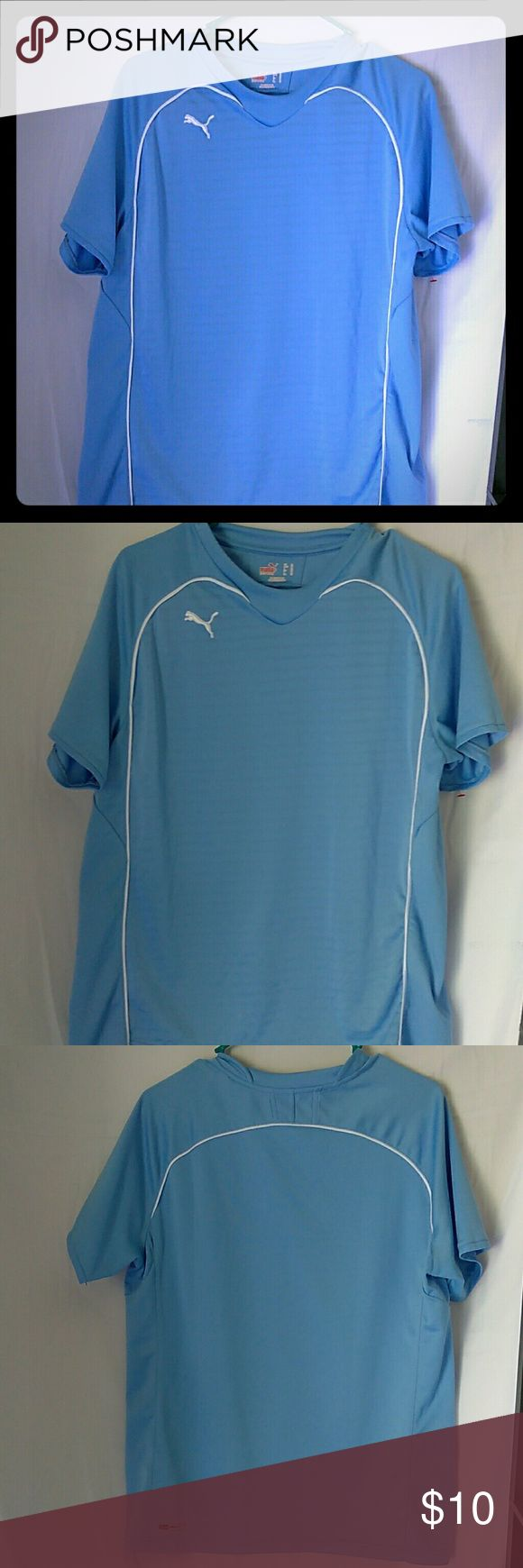 Puma Xl light blue work out shirt Puma XL work out shirt blue with either accent used but still in good condition. Puma Shirts Tees - Short Sleeve
