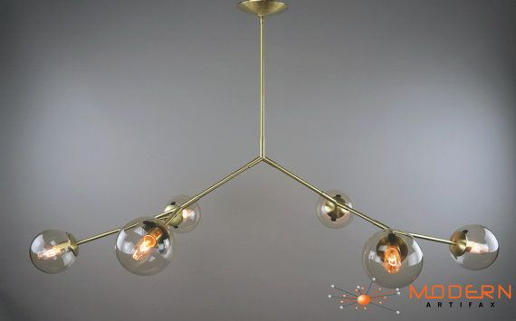 """This is Branching Element I: Solid Brass, Satin Finish The lamp comes with 6 Light Smoke Glass Globes. Various Glass Globes are available upon request. It uses medium base socket bulbs. (We recommend 40 watt max bulbs) The lamp measures 68"""" in length with Glass Globes. Custom sizes drop rods are available upon request. The lamp has a width of approximately 41 including Glass Globes. Light bulbs ARE included (25W). This lamp can be used with a dimmer to achieve your desired effect  This…"""
