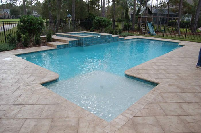 Square spillover spa w steps pool patio design for Pool design with tanning ledge