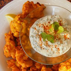 Spicy South African 'Chilli Bites' - corn fritters with a minty yoghurt dip.