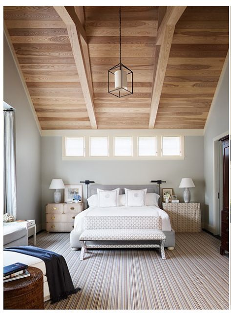 I love the color contrast of the wood ceiling and the walls in this room. I like the bank of small windows, that might be something that would work in the living room above the fireplace as well.: