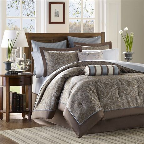"""If classic is your style, Aubrey is perfect for you.  The jacquard weave is inspired from an updated paisley motif and is woven in a beautiful combination of soft blue, taupe and and a hint of platinum.  The comforter and shams offer beautiful details with a 2"""" flange and 1/2"""" flat piping in soft blue.  The reverse of the comforter is a soft brown color.  The sheets 100% cotton, 200 thread count, and the soft blue coordinates back perfectly to the bedding collection."""