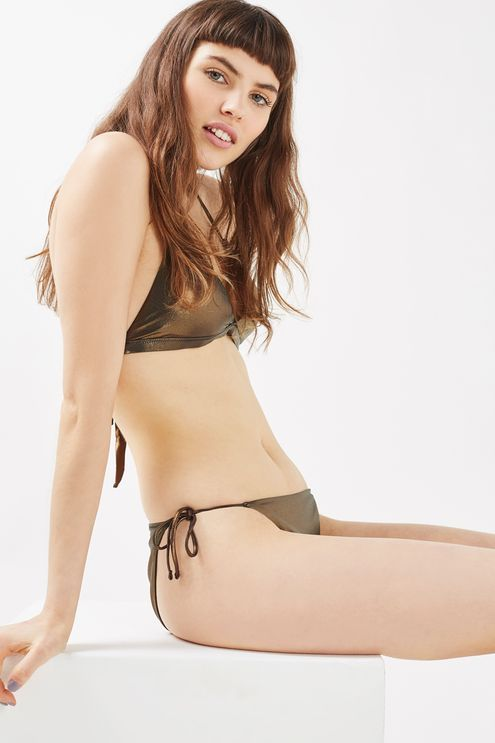 Give your swimwear a metallic makeover in this silver triangle bikini top with a halter neck tie. Match with the metallic bikini bottoms for a co-ordinated-cool look for the beach.