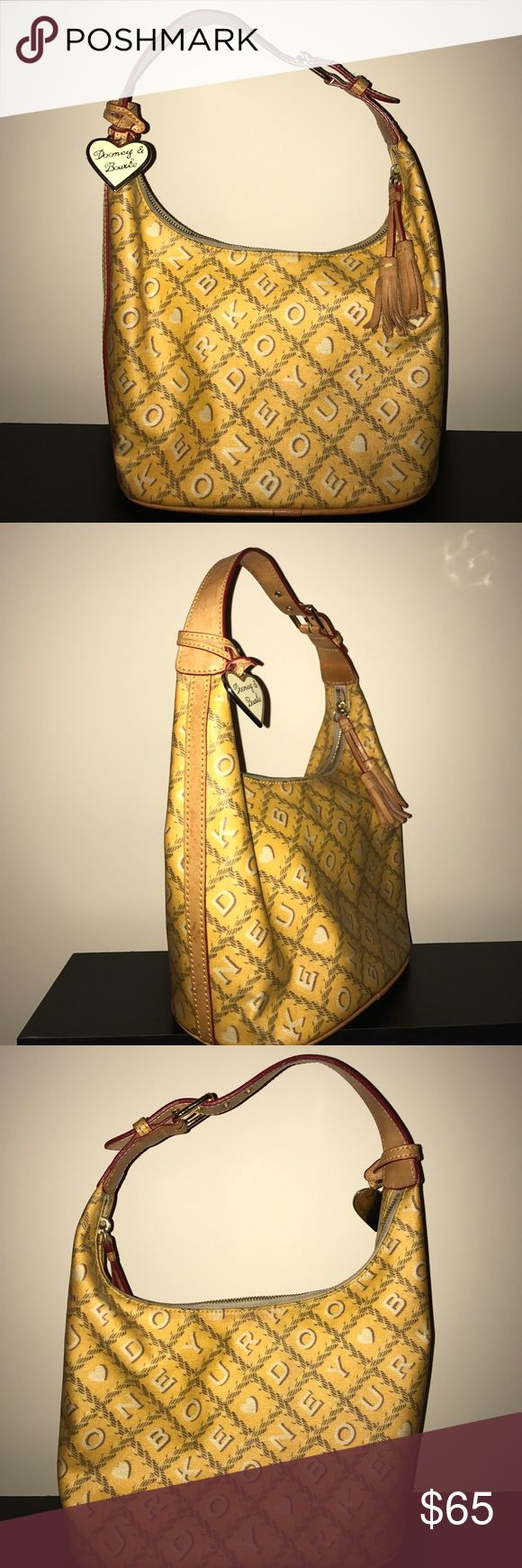 Dooney and Bourne hobo Used but still in great condition hobo. Dress it up for evening out or dress it down for day around town. Dooney & Bourke Bags Hobos