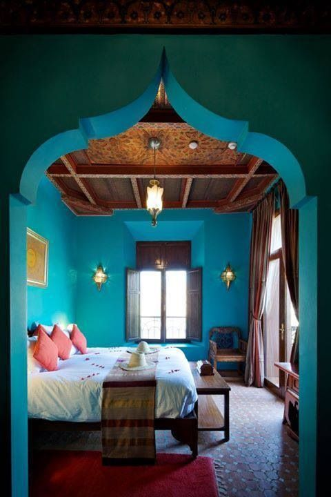 Morocco style- so rich with the dark wood, saturated teal color... pops with the white fabrics