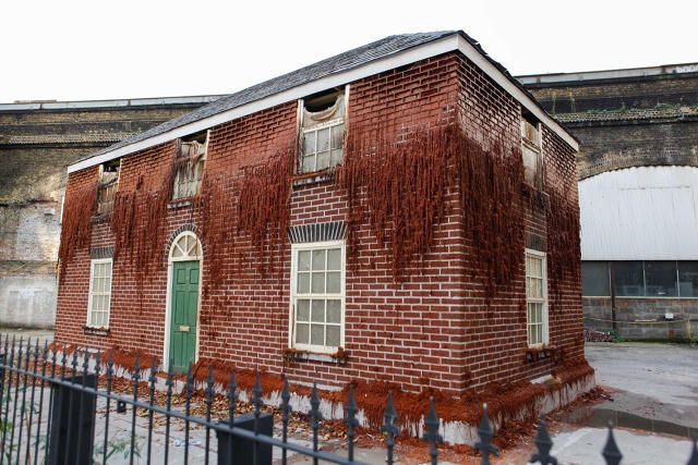Alex Chinneck Builds Melting Brick House for London's Merge Festival | Hi-Fructose Magazine