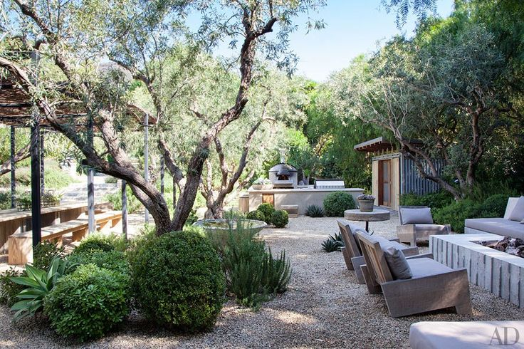 Kinda like the chairs; maybe because they remind me of Adirondack chairs? Also the fire pit, and the large vessel between the trees. Patrick Dempsey's Malibu Home