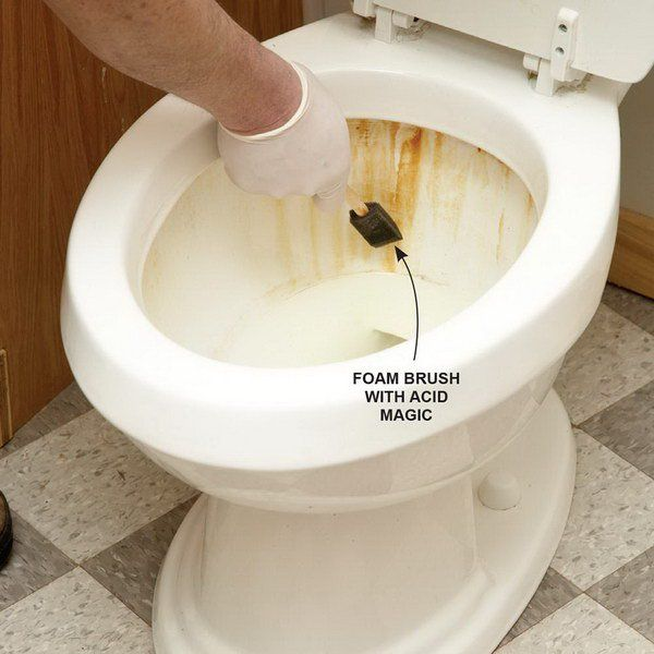 Remove stubborn rust stains from the toilet using foam brush and acid magic.