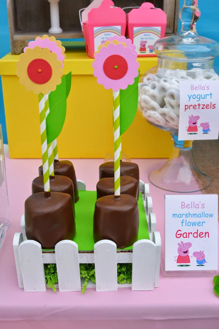 "It's a Peppa and George kinda party! Peppa is gardening and her flowers are in full bloom. Chocolate covered giant marshmallows as ""dirt"" with the flowers in bloom."