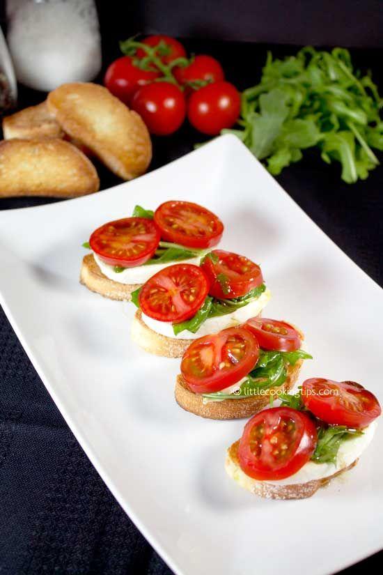 Tomato Mozzarella & Arugula Crostini: The only tomato mozzarella appetizer you 'll need.