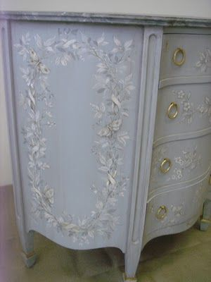 Pale blue painted dresser with floral design by artist Patrick Roullier