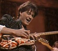 On this day in 1987, Eddie Van Halen finger-tapped and whammy-bar-dived his way through a bluesy rave-up alongside G. E. Smith and the Saturday Night Live band. The footage of the jam is constantly being taken down from YouTube, but today we discovered a pristine video supplied by SNL