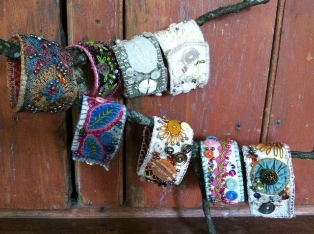 Hand embroidered, beaded, buttoned, and appliqued fabric cuff bracelets from True North Interior Design & Antiques