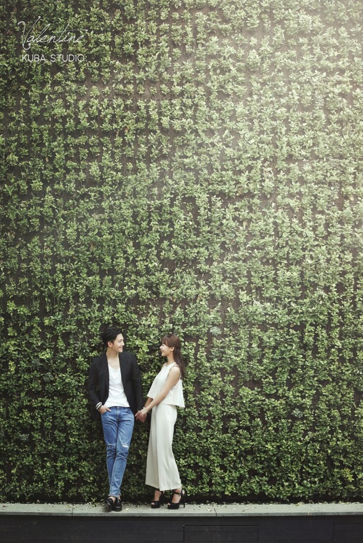 Couple, Side facing, Full body shot, Buildings, Casual outfit