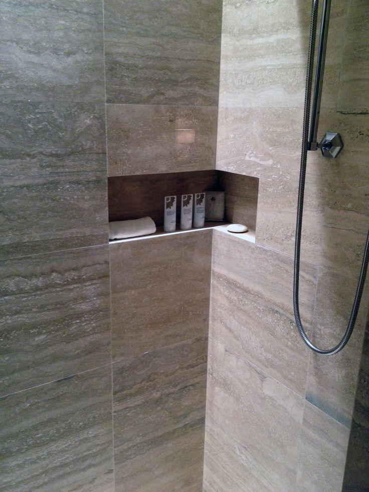 Shower shelf or niche wraps around the corner. Great idea
