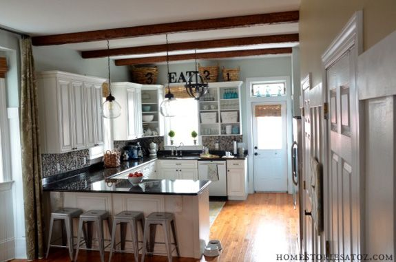 love removing the doors to the upper cabinets, opens up the kitchen. Might do this in my new kitchen.