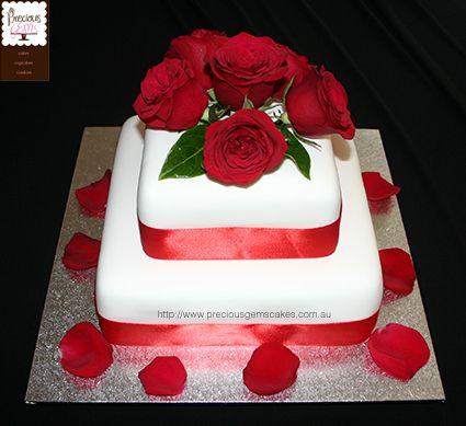 2 tier wedding cake with fresh roses and rose petals by preciousgemscakes.com.au