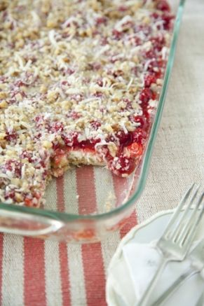 Paula Deen Holiday Cherry Cheesecake | Crust: 1 cup chopped walnuts 1 1/4 cup flour 1/2 cup brown sugar 1/2 cup shortening 1/2 cup sweetened coconut Filling: 2 (8 oz.) packages of cream cheese, softened 2/3 cups sugar 2 eggs 2 tsp. vanilla extract 2 (21 oz.) cans cherry pie filling