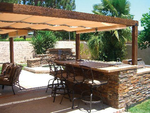 LOVE IT!!!! outdoor-kitchen by ShadeTree Canopies