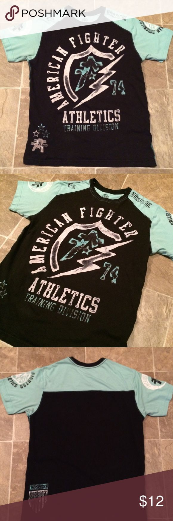 Men's American Fighter shirt Men's short sleeve American Fighter shirt. Says size M but it fits more like a small. Arm pit to arm pit 19in Length is 27in  Smoke free and pet free home  Reasonable offers accepted  Bundle and save American Fighter Shirts Tees - Short Sleeve