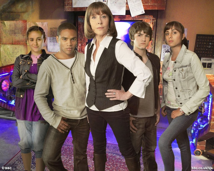 "Sarah Jane Smith (Elizabeth Sladen) with her own companions from ""The Sarah Jane Adventures."""
