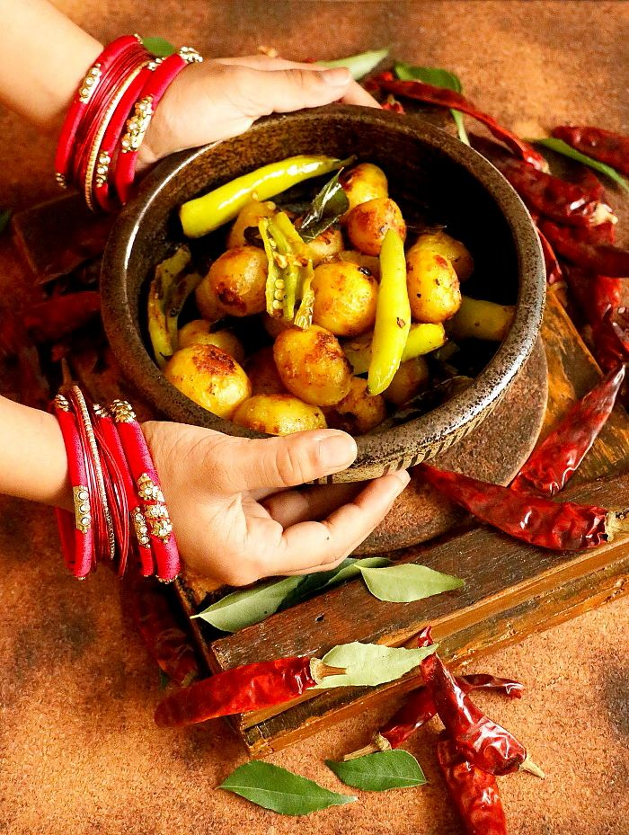 bajji molaga baby potato fry is a tasty side dish for rice made with a combination of bajji molaga and baby potato. can be served as a side dish for rice.