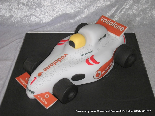 Racing Car Cake. Formula one racing cake cake finished with edible printed Vodafone logos