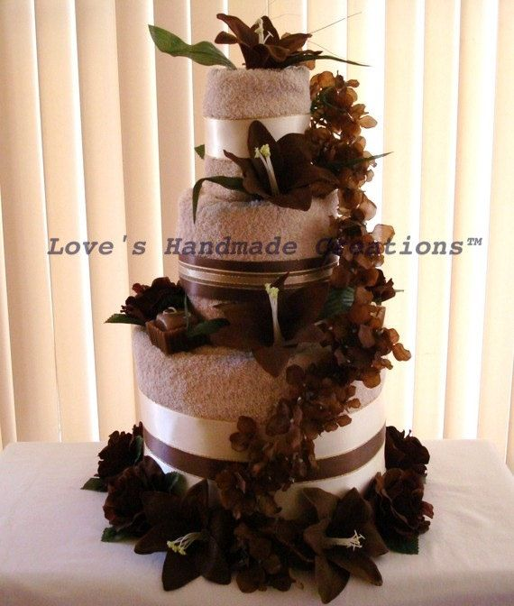 Hey, I found this really awesome Etsy listing at http://www.etsy.com/listing/58468694/wedding-towel-cake-floral-design