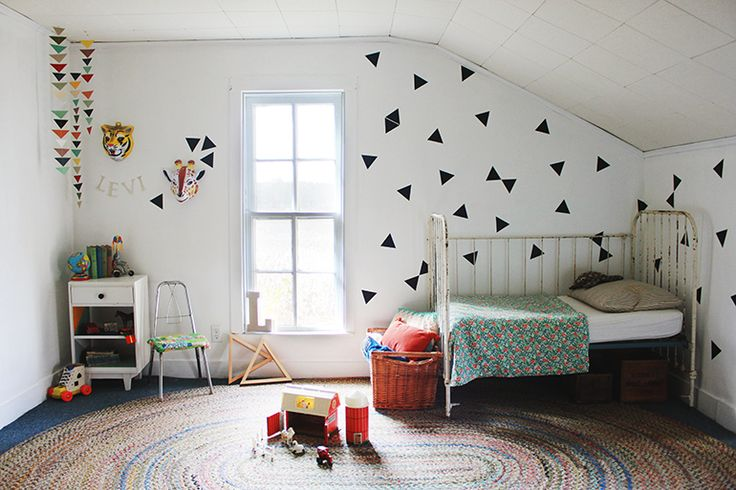 Triangle Wall Decals // Levi's Room - The Merrythought Love the name in newsprint and also the triangles in the corner.  Lovely room!